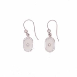 boucles d'oreilles ovales or blanc 18k diamants et corail blanc du Japon.